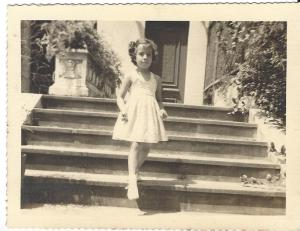 Martica de Aragón, 3 years olds, at the steps of our paternal grandmother´s home in Calle C, El Vedado. La Habana